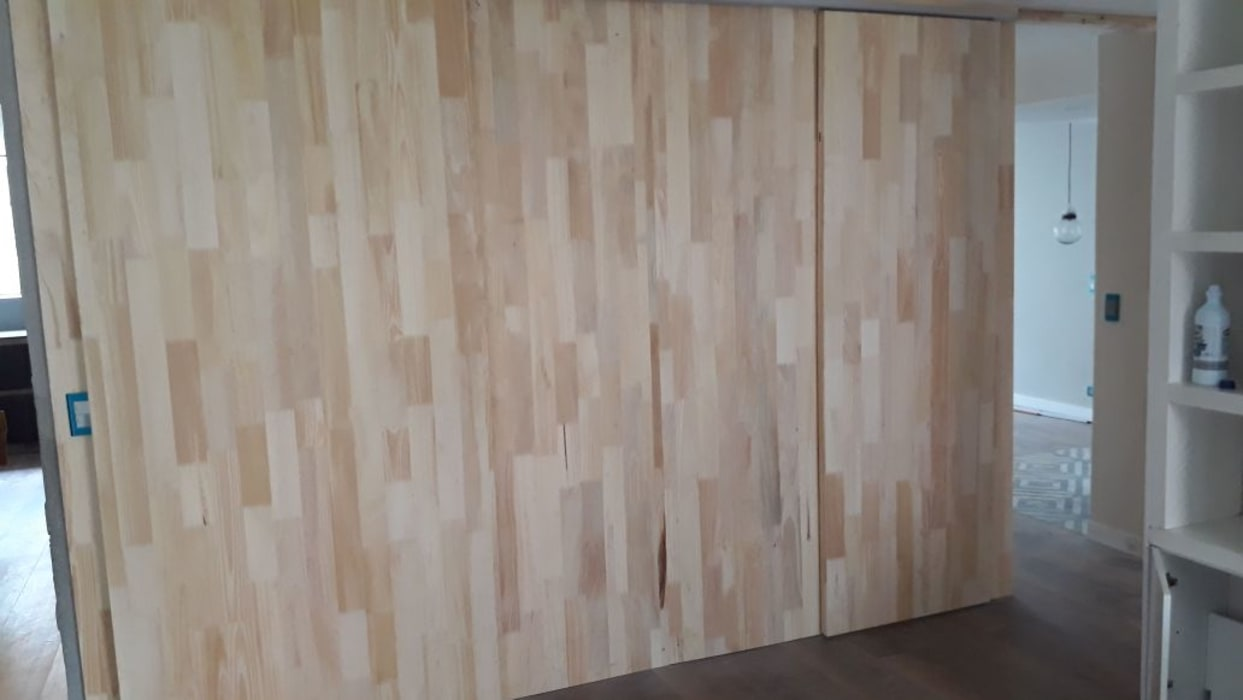 Puertas corredizas de Cosmoservicios SAS Moderno Madera Acabado en madera