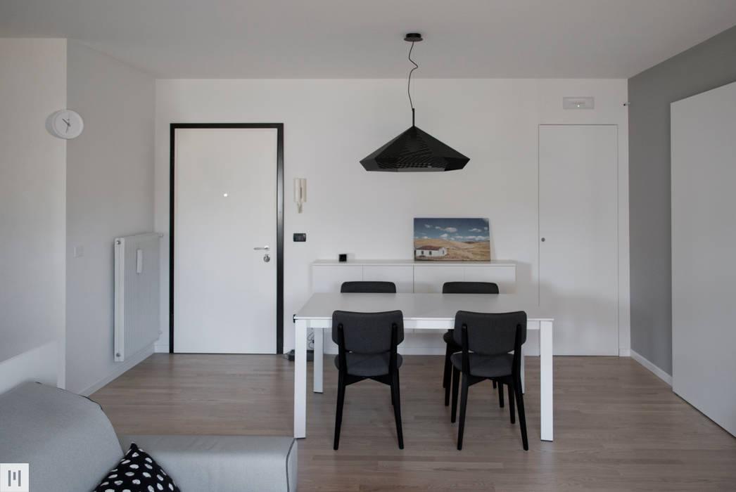 La zona pranzo: Soggiorno in stile in stile Moderno di Margherita Mattiussi architetto
