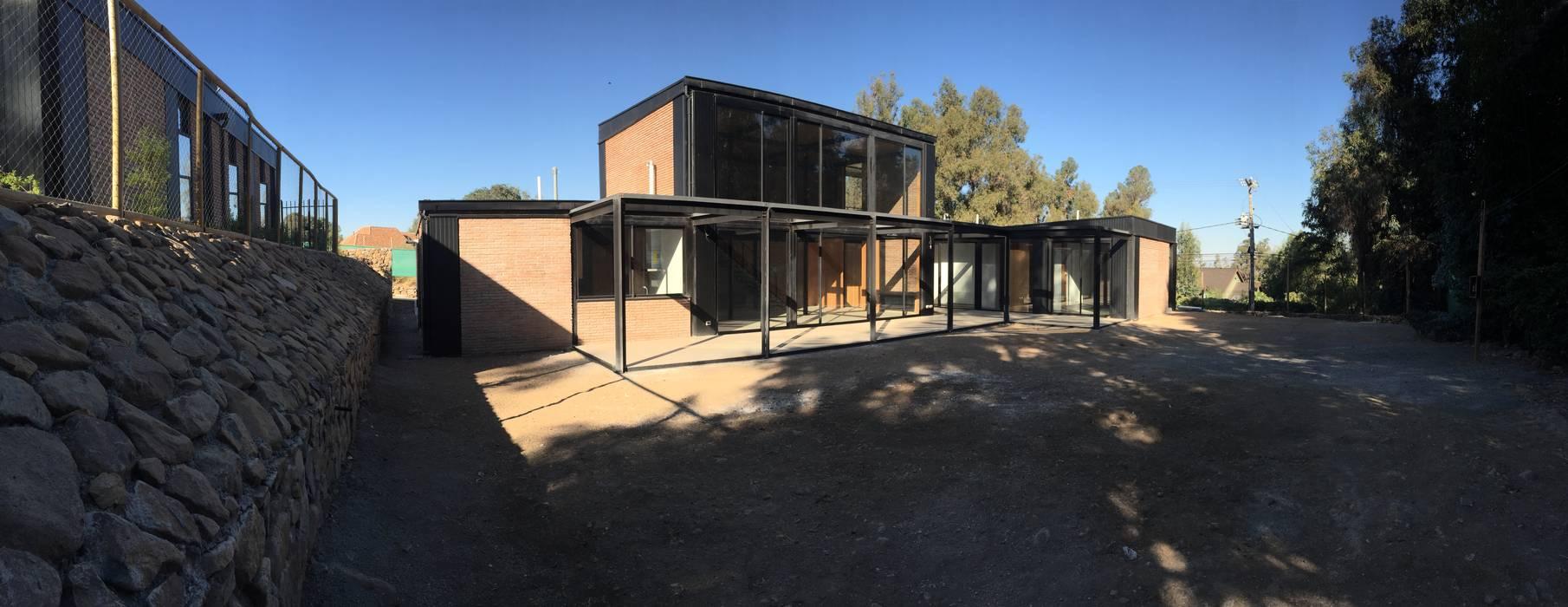Fachada: Casas de estilo industrial por MAC SPA
