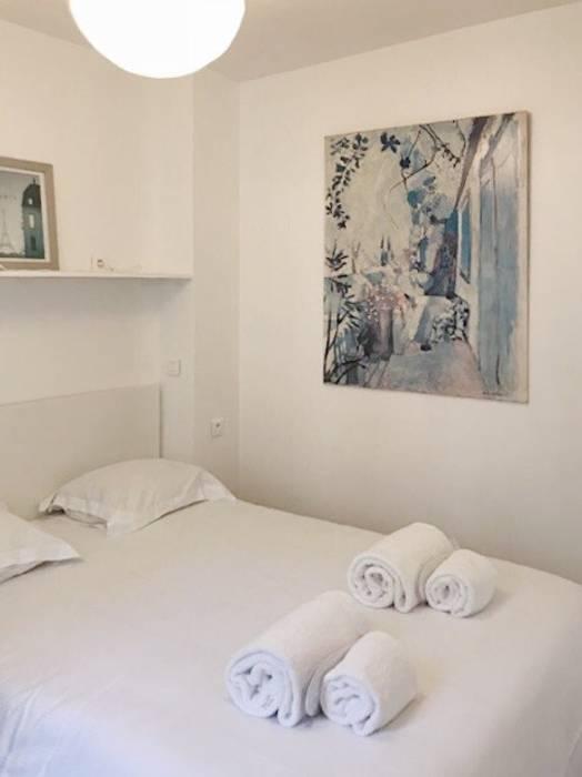 Appartamento a Parigi Camera da letto in stile rustico di smellof.DESIGN Rustico