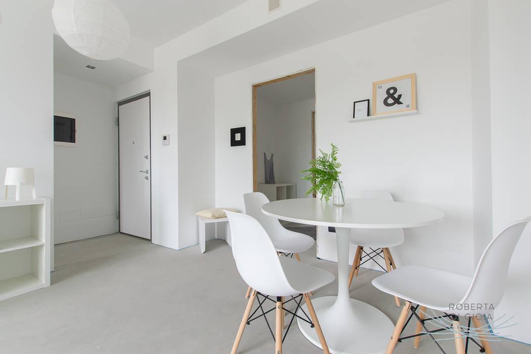 Appartamento in cantiere senza rivestimenti e porte: Sala da pranzo in stile in stile Moderno di Home Staging & Dintorni