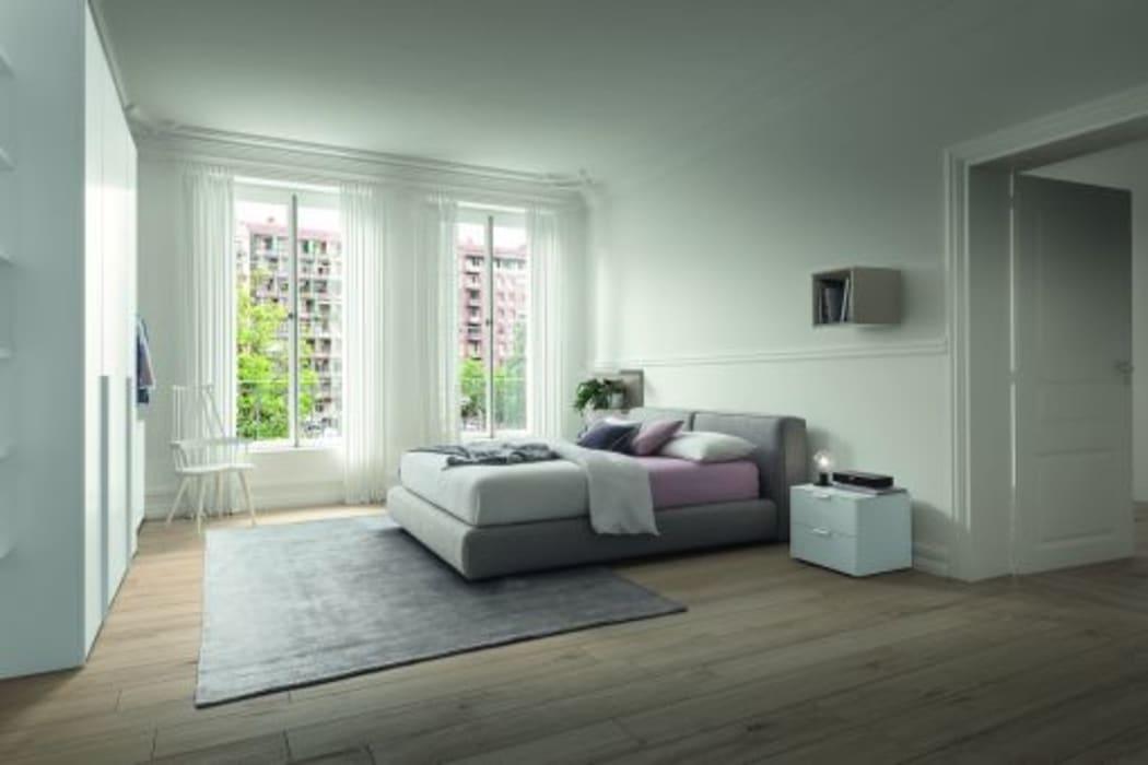 Lo stile moderno in camera da letto: Camera da letto in stile  di Ferrari Arredo & Design