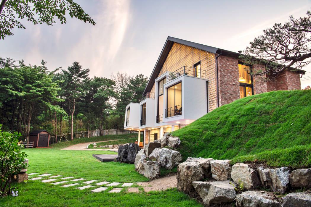 남양주 별장: 위 종합건축사사무소의  주택