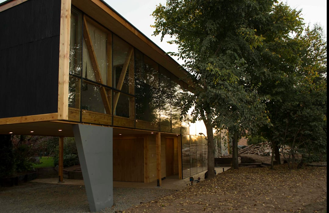 Fachada Norte y bosque Casas estilo moderno: ideas, arquitectura e imágenes de PhilippeGameArquitectos Moderno Vidrio