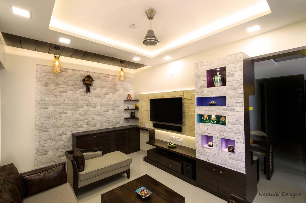 TV unit 现代客厅設計點子、靈感 & 圖片 根據 Navmiti Designs 現代風