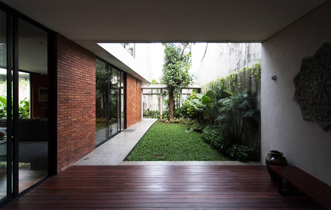 Jardin moderne par WOSO Studio Moderne