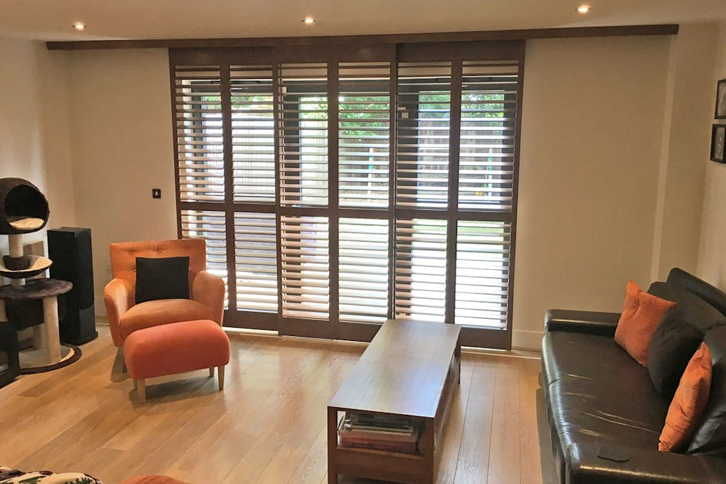 Full Height Shutters On A Track System In The Living Room
