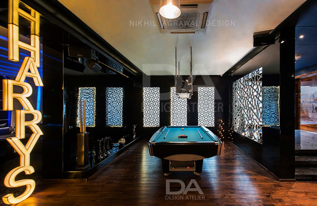 Pool Table Area with client's name cutout in back lit MDF:  Pool by Design Atelier,Modern
