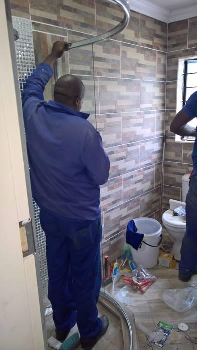 Ванная комната в стиле модерн от Kgodisho Solutions and Projects Модерн