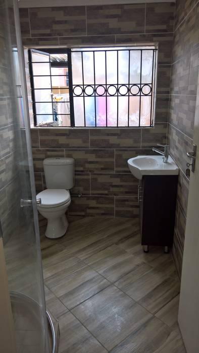 Baños de estilo moderno de Kgodisho Solutions and Projects Moderno