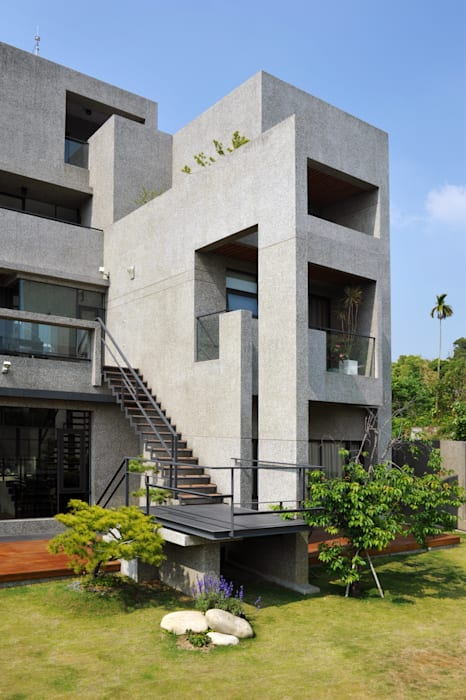 Nhà theo 黃耀德建築師事務所  Adermark Design Studio,