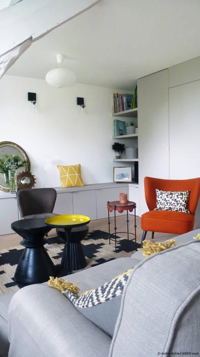 Avenue de Choisy: Salon de style  par Atelier Sylvie Cahen