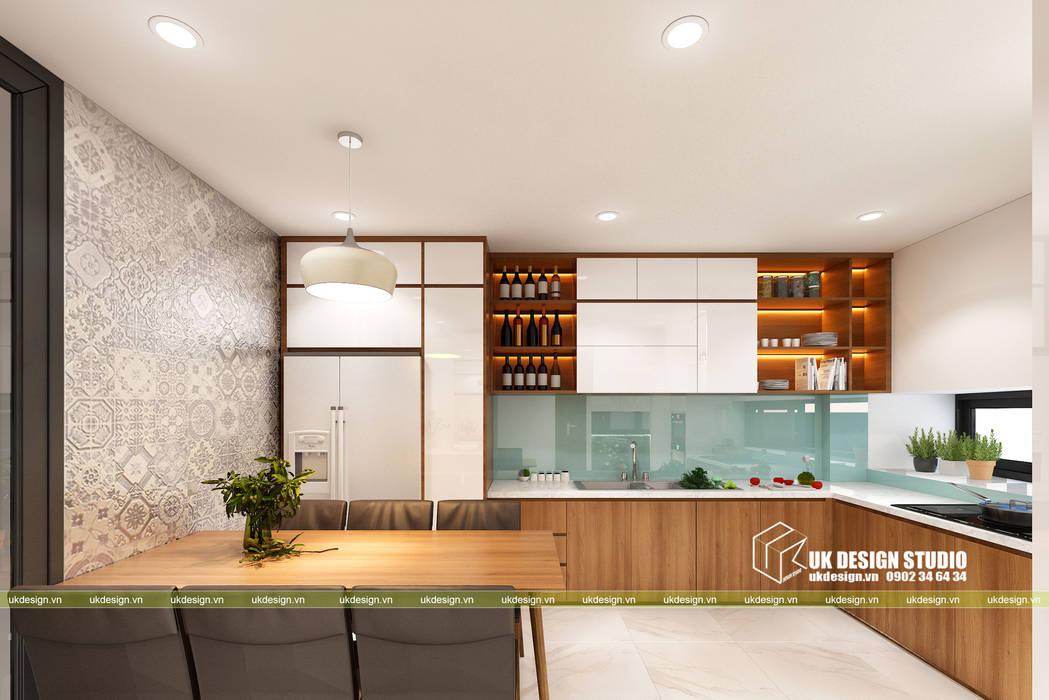 NHÀ PHỐ KẾT HỢP VĂN PHÒNG:  Tủ bếp by UK DESIGN STUDIO - KIẾN TRÚC UK,