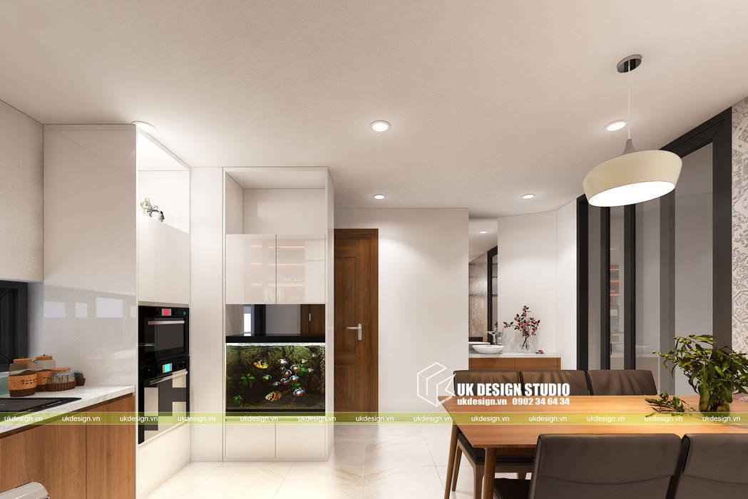 NHÀ PHỐ KẾT HỢP VĂN PHÒNG:  Tủ bếp by UK DESIGN STUDIO - KIẾN TRÚC UK, Hiện đại