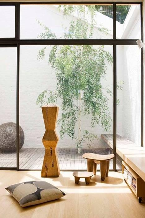Nội thất gỗ luôn được ưu tiên sử dụng trong thiết kế nhà theo phong cách Nhật Phòng khách phong cách châu Á bởi Công ty Thiết Kế Xây Dựng Song Phát Châu Á