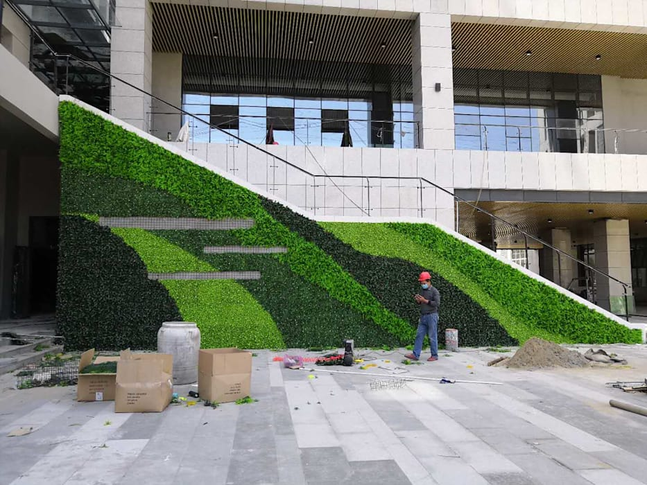 Unsightly wall covering with artificial hedges plants Modern office buildings by Sunwing Industries Ltd Modern Plastic