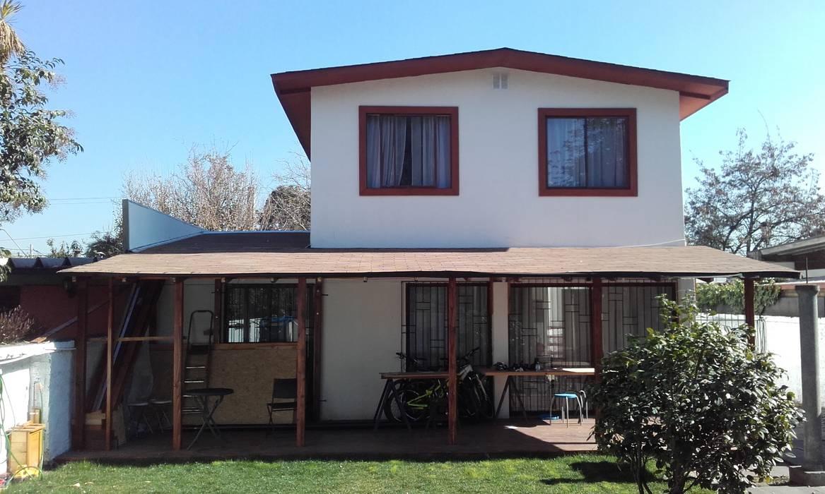 Fachada posterior nueva DIEGO ALARCÓN & MANUEL RUBIO ARQUITECTOS LIMITADA Casas unifamiliares