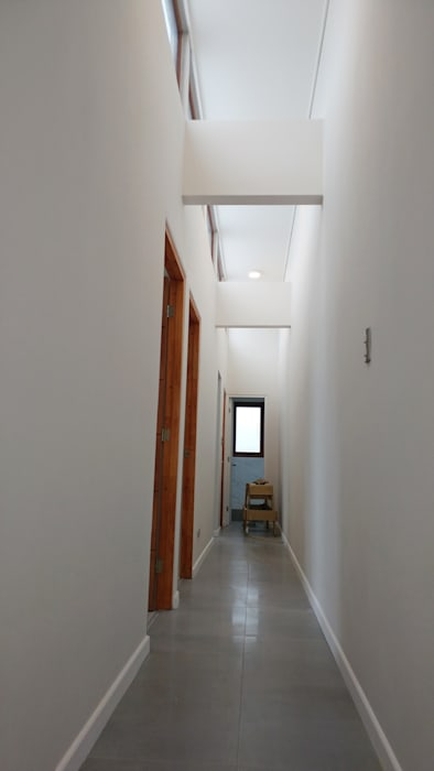 Casa Lomas De Montemar Pasillos, vestíbulos y escaleras modernos de Lau Arquitectos Moderno