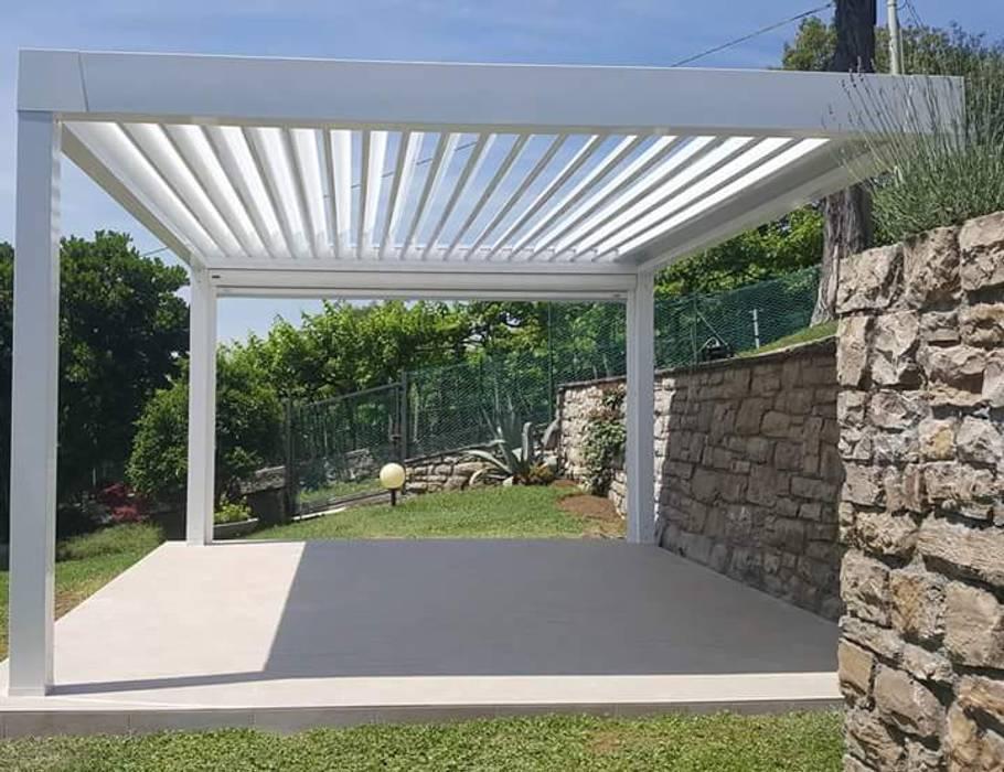 bioclimatica: Giardino con piscina in stile  di zinesi design
