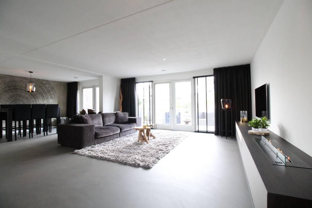 Cementgebonden gietvloer in moderne stoere woonkamer: vloeren door ...