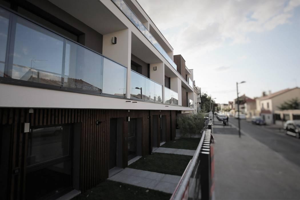 Projekty,  Dom wielorodzinny zaprojektowane przez OGGOstudioarchitects, unipessoal lda