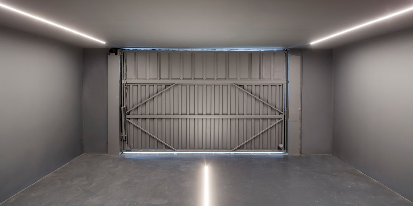 : Garajes dobles de estilo  de CRÜ studio
