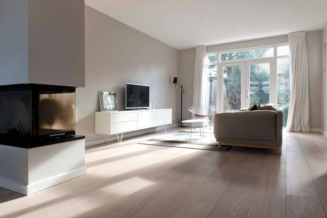Verbouwing familiewoning Den Haag:  Woonkamer door Atelier Perspective Interieurarchitectuur