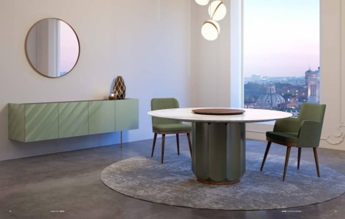 mesa redonda com prato rotativo madeira: Salas de jantar  por CRISTINA AFONSO, Design de Interiores, uNIP. Lda