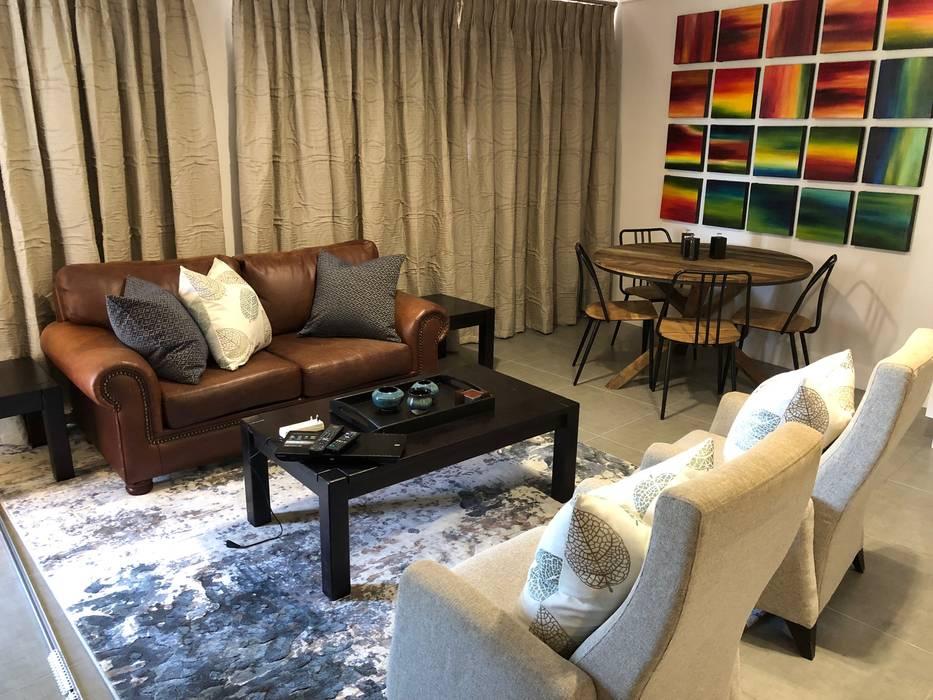 Living area:  Living room by Lean van der Merwe Interiors