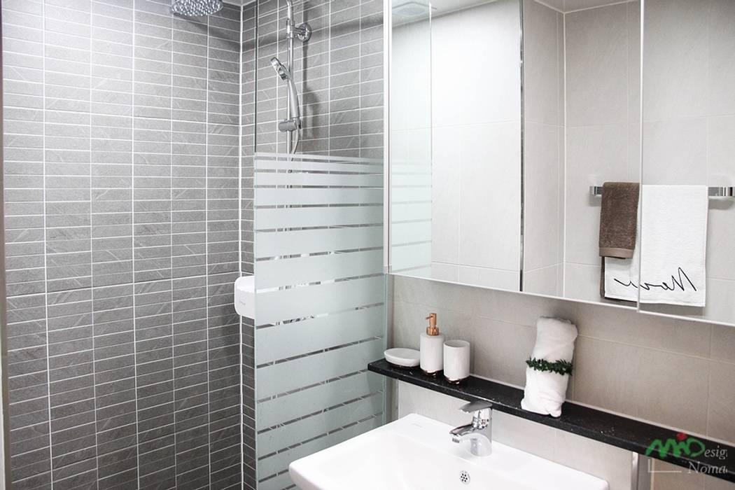 Bathroom by 노마드디자인 / Nomad design