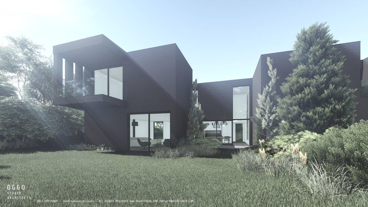 Dark grey volumes of the houses Taman Modern Oleh OGGOstudioarchitects, unipessoal lda Modern