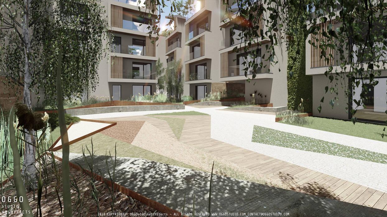Housing project of 120 apartments Taman Modern Oleh OGGOstudioarchitects, unipessoal lda Modern