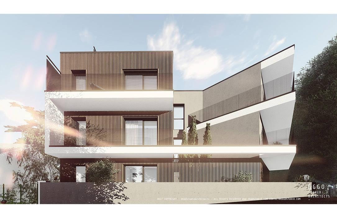 Jogo de planos e volumes em projecto de habitação: Casas  por OGGOstudioarchitects, unipessoal lda