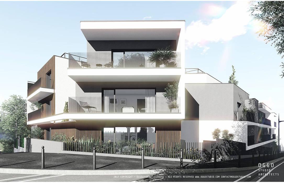 Varandas em edifício de habitação colectiva - Vaillant: Casas  por OGGOstudioarchitects, unipessoal lda