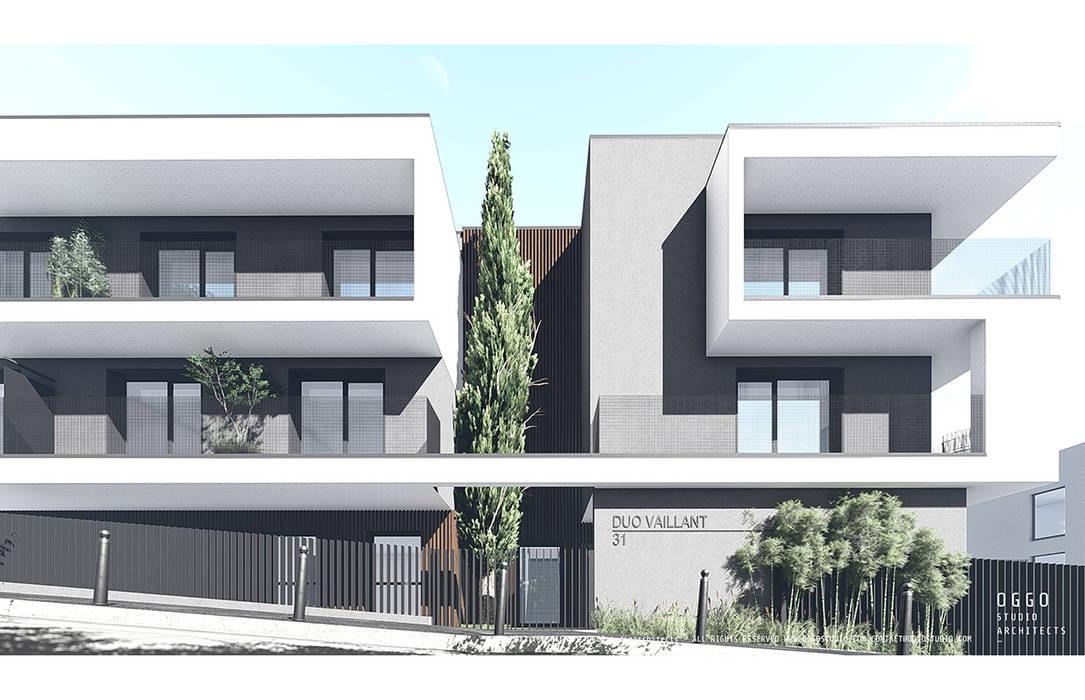 Entrada no edifício de habitação colectiva Vaillant: Casas  por OGGOstudioarchitects, unipessoal lda