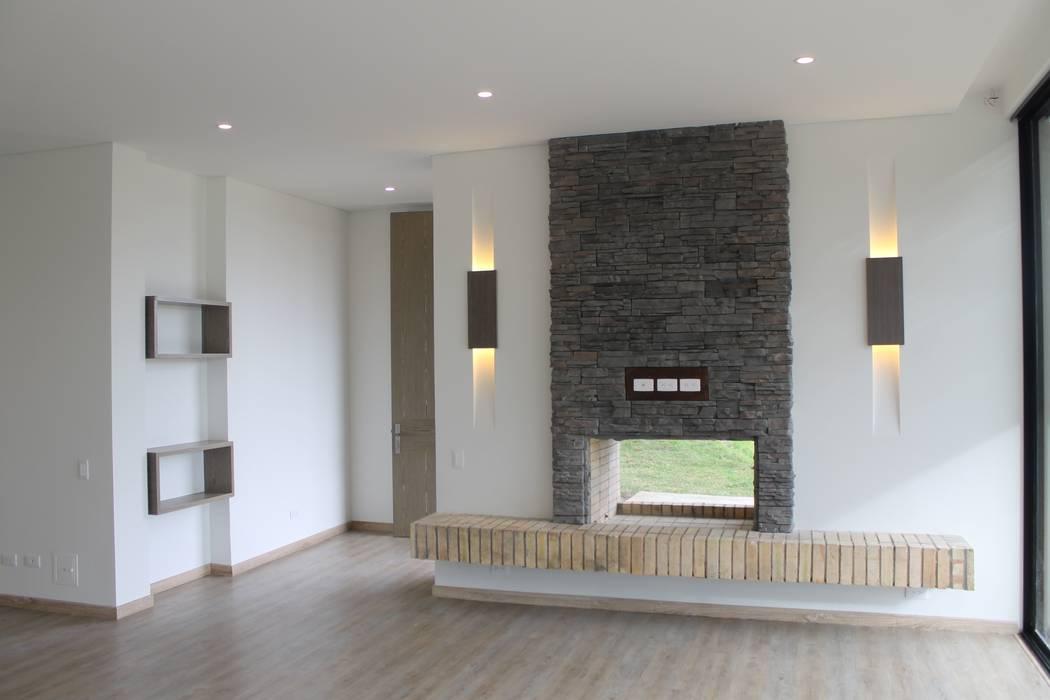 chimenea: Comedores de estilo  por IngeniARQ Arquitectura + Ingeniería