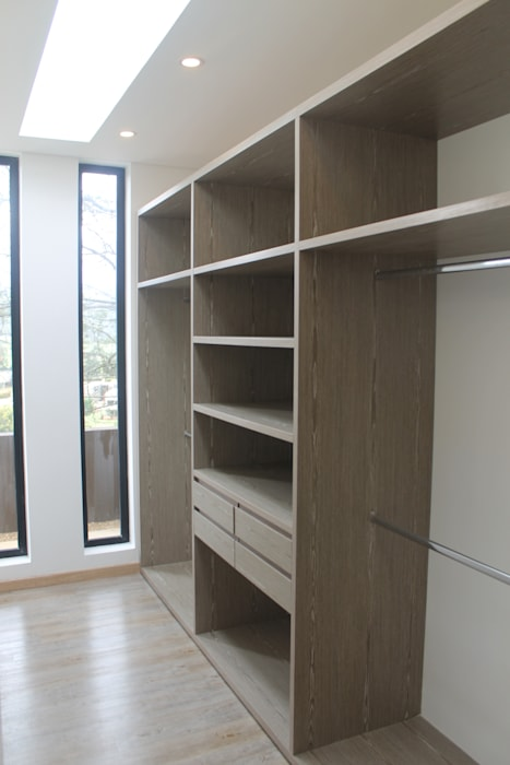vestier: Vestidores de estilo  por IngeniARQ Arquitectura + Ingeniería, Moderno