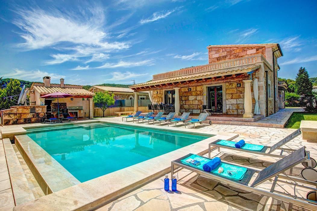 Fachada, vista exterior: Casas unifamilares de estilo  de Diego Cuttone, arquitectos en Mallorca, Mediterráneo Piedra