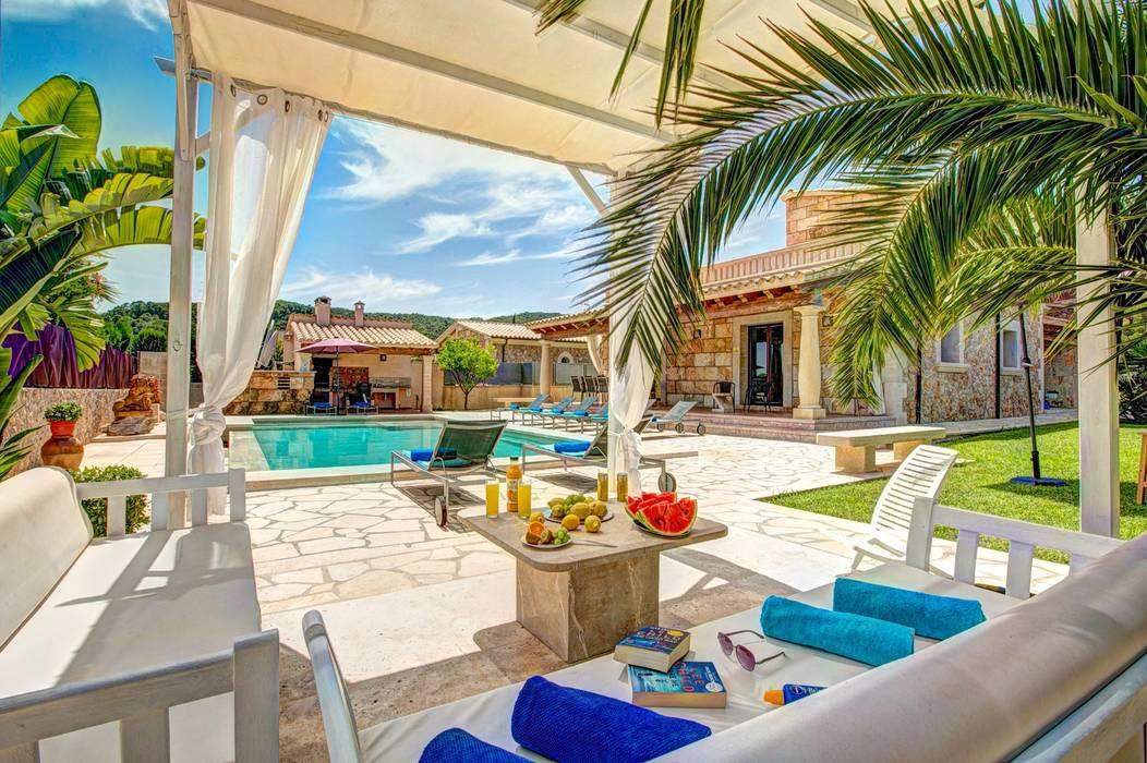 Porche: Terrazas de estilo  de Diego Cuttone, arquitectos en Mallorca, Mediterráneo