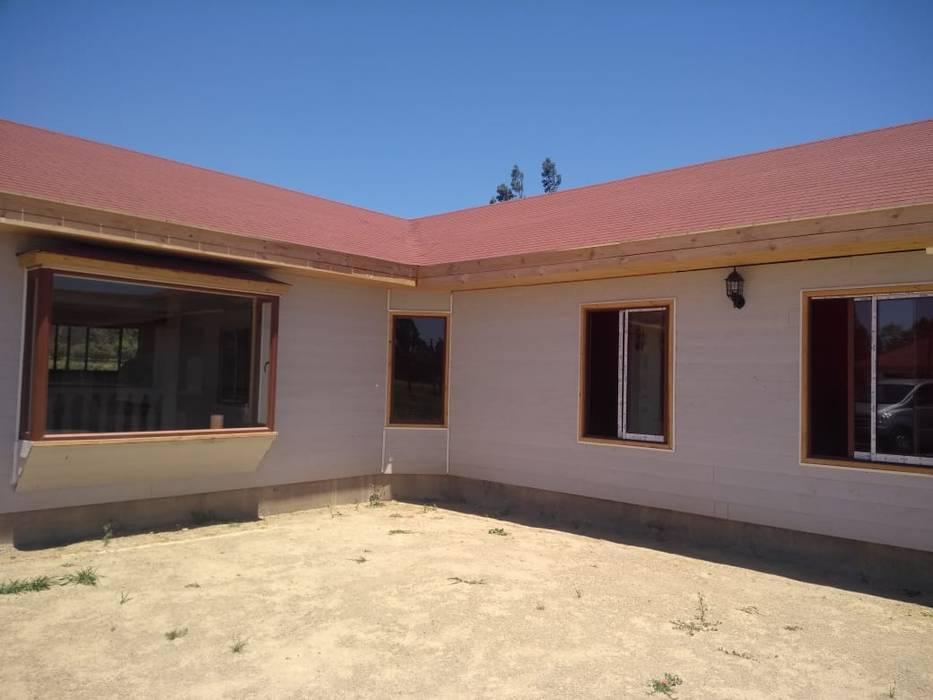 Construcción de Casa en Melipilla por Constuctora Santa Raquel de Sociedad de Inversiones Atcosan ltda. Moderno