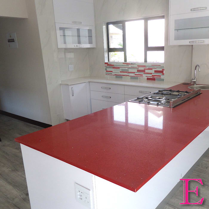 Ultra Modern Kitchen with Red Focalpoint by Ergo Designer Kitchens and Cabinetry Modern Engineered Wood Transparent
