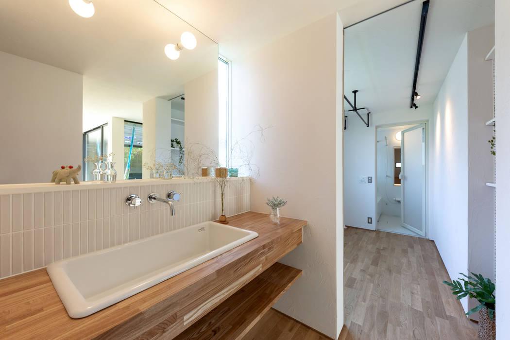 洗面&ランドリー: まんなみ設計室が手掛けたサンルームです。