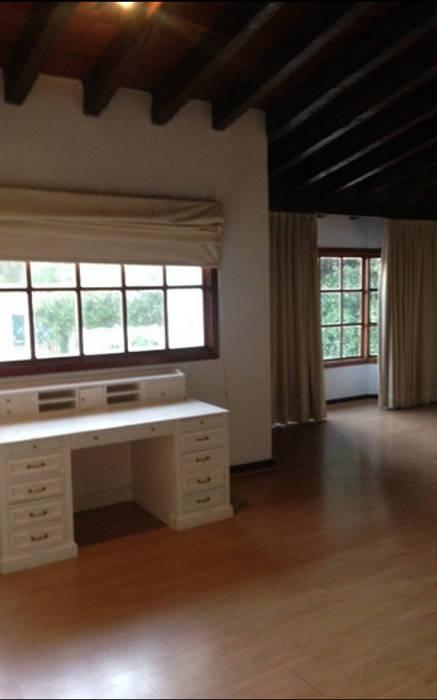 Dormitorios de estilo  de NettelHaus,