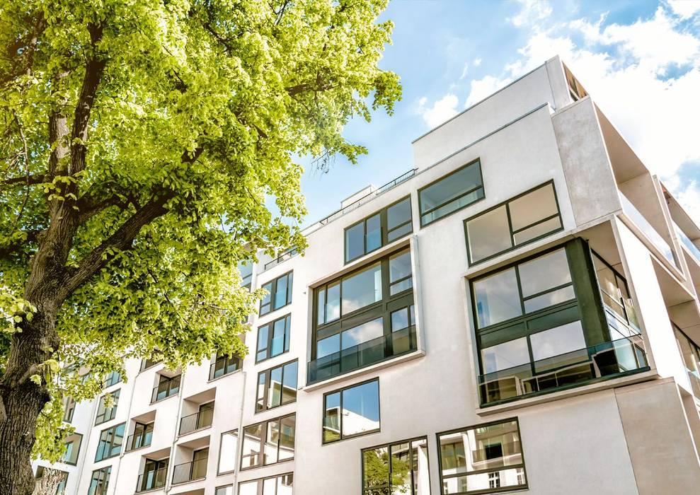Construcción de pisos y chalets en Málaga: Casas multifamiliares de estilo  de Klausroom