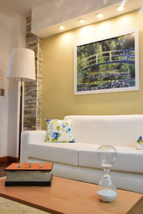 Living con combinación de colores tierra, gris y blanco Livings modernos: Ideas, imágenes y decoración de Arquimundo 3g - Diseño de Interiores - Ciudad de Buenos Aires Moderno