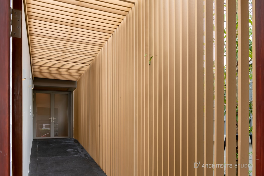 Dinding & Lantai Modern Oleh D' Architects Studio Modern
