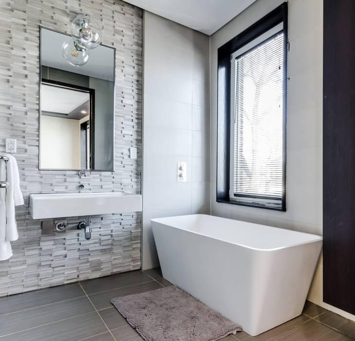 Remodelación : Baños de estilo  por Arkited