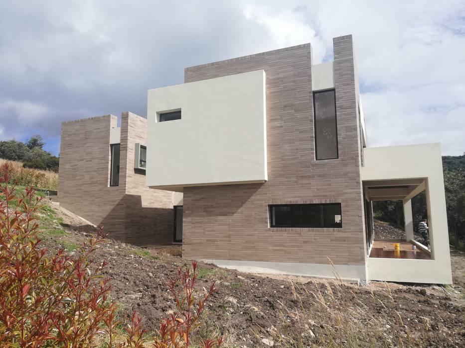 FACHADA SUR 2: Casas de estilo moderno por IngeniARQ Arquitectura + Ingeniería
