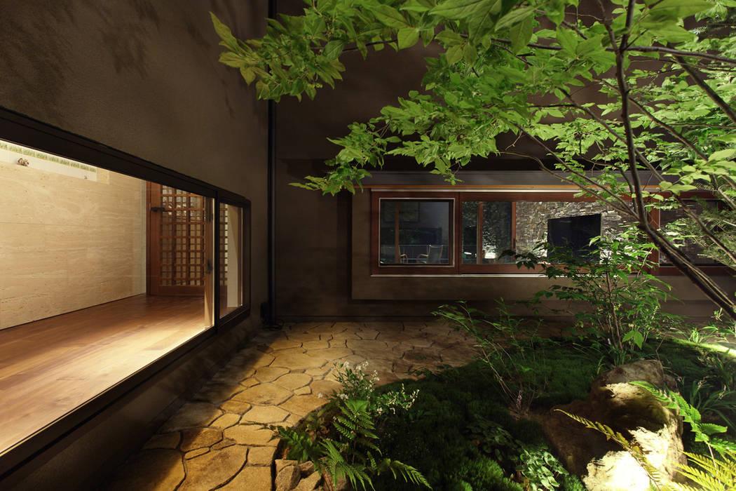 森と暮らす家 -週末住宅- の Studio tanpopo-gumi 一級建築士事務所 モダン