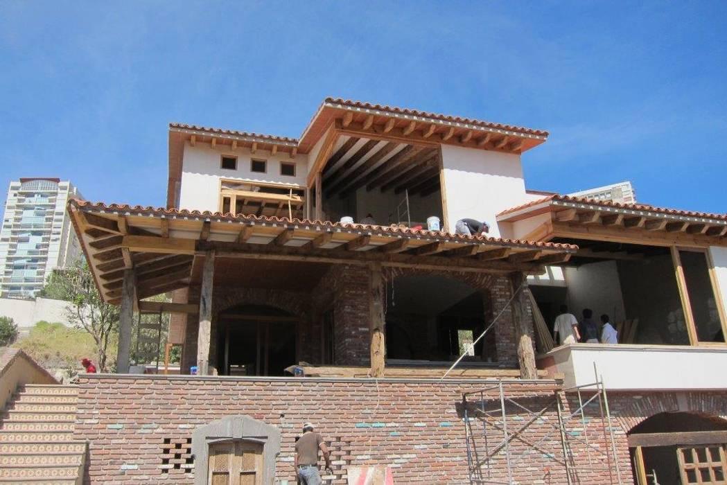 Rumah kayu oleh HERRERA ARQUITECTOS, Modern